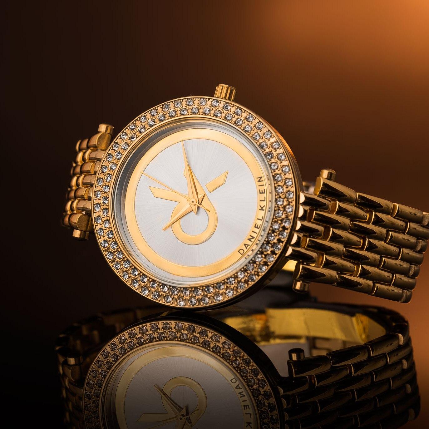 Daniel Klein Gold watch in orange light